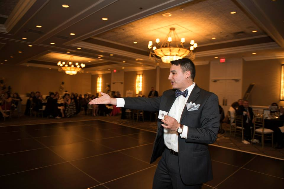 Chicago Magician David Ranalli on Stage performing is corporate magic and comedy